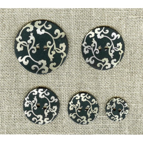 Engraved mother-of-pearl button Arabesque, natural on black background