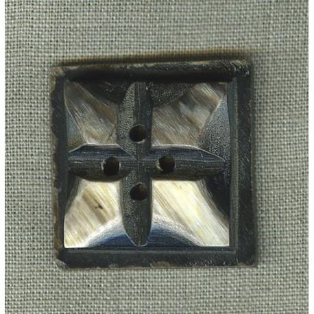 Button in black horn.